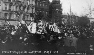 Crowd Breaking Up Womans suffrage parade